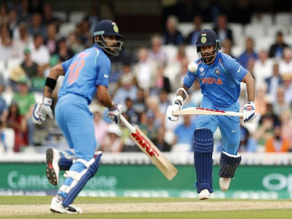 India's Shikhar Dhawan (R) and Virat Kohli in action